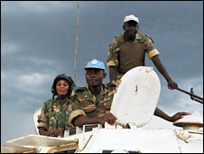 Ashraf Qazi (c), head of the UN's mission in Sudan, travels round Abyei in an armoured personnel carrier