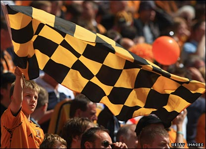 Hull City fans wave flags ahead of the Championship play-off final