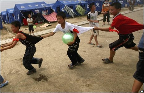 Earthquake survivors play a game in Mianzhu