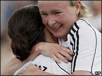 Frankfurt goalscorer Conny Pohlers (r) celebrates with Birgit Prinz