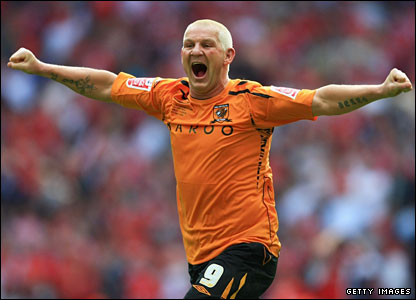 Dean Windass charges on the pitch victoriously