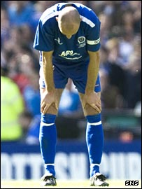 Dejected Queens captain Jim Thomson