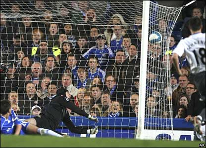 Emile Heskey (bottom right, obscured) scores for Wigan v Chelsea