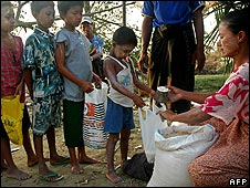 Children line up for rice in Dedaye township