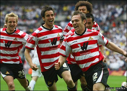 James Hayter of Doncaster Rovers (front) celebrates with team-mates as he scores their first goal