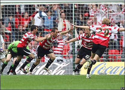 James Hayter (centre) celebrates scoring his sides first goal of the game with his team-mates