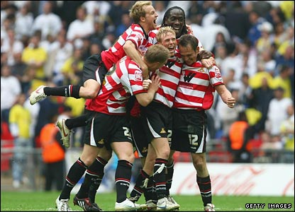 James Hayter of Rovers (r) and team-mates celebrate victory