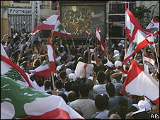 Lebanese watch the swearing-in of President Michel Suleiman at his home town Aamchit, north of Beirut