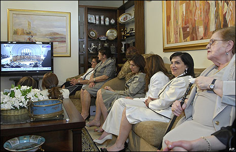 Wafaa Suleiman (second right), wife of Lebanese President Michel Suleiman, watches the elections with family members in Suleiman's Beirut house