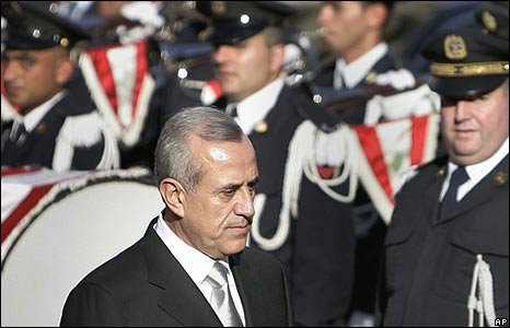 Lebanese President Michel Suleiman passes honour guard outside parliament