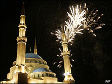 Fireworks behind the Mohammed al-Amin mosque in Beirut 25 May