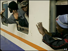 Mozambicans on a train leaving South Africa