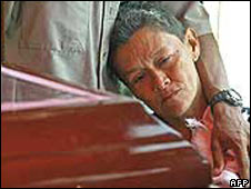 A Colombian woman grieves by the coffin of her son, in Antioquia in February 2005