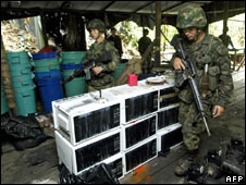 Colombian soldiers walk inside a cocaine laboratory in Tumaco, Colombia on 17 May