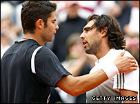 Simone Bolelli (left) shakes hands with Marcos Baghdatis
