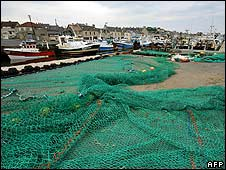 Fishing boasts are docked and nets are spread on the harbour in protest in Port-de-Bessin on 24 May
