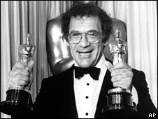 Sydney Pollack holds his two Oscars at the Academy Awards in Los Angeles, 25 March, 1986