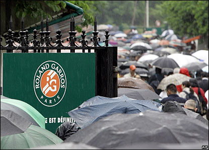 Day three at Roland Garros begins as day two ended - with heavy rain and no play