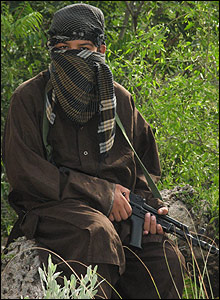 Hamza, a 13-year-old militant