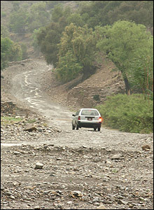 A taxi heads through the rain in the picturesque scenery of South Waziristan