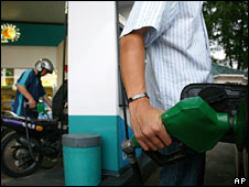 Motorists fill up their vehicles with gasoline at a petrol station in Subang, Malaysia
