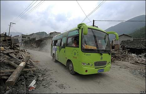 Survivors on a bus evacuate from Leigu town of Beichuan County, China