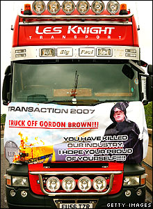 Protest poster on the front of a truck