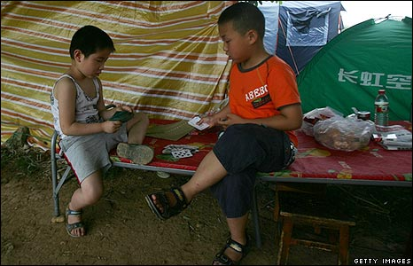 Children who have moved to higher ground play cards in Mianyang City, Sichuan Province
