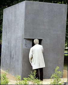 A man looks at a video screen inside the Berlin memorial for homosexual victims of Nazi persecution, 27 May, 2008