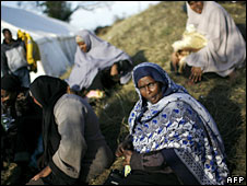 A group of Somali women sit outside a tent at an informal refugee camp on the outskirts of Pretoria, 27 May, 2008