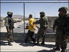 Mexican troops question a man during an anti-drug operation in Ciudad Juarez on 13 May