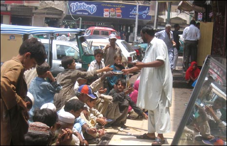 Food being distributed outside Sabri Hotel