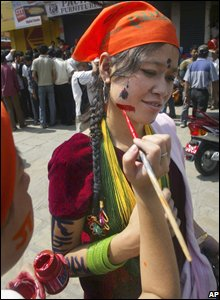 Nepalese woman gets her face painted