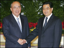 "Taiwan""s ruling Nationalist Party Chairman Wu Poh-hsiung, left, is greeted by Chinese President Hu Jintao during their meeting in Beijing""s Great Hall of the People Wednesday May 28, 2008"