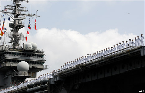 US sailors line up for a last farewell on board the USS Kitty Hawk