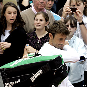 Juan Carlos Ferrero, the 2003 champion, is forced to retire from his clash with Marcos Daniel with a leg injury