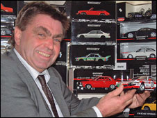 Halls toy specialist Stewart Orr with the model cars (picture: Halls)