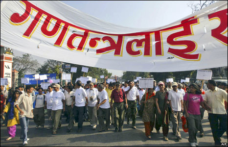 Nepalese celebrate the end of monarchy outside the convention hall in Katmandu