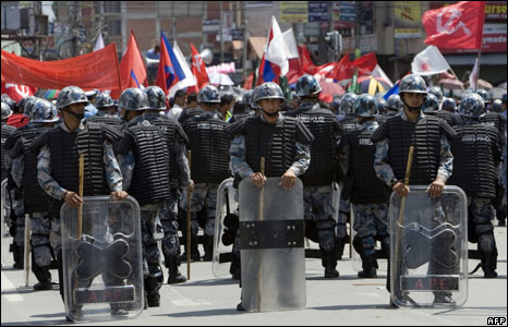 Nepali riot police stand guard  in Kathmandu as Maoists stage a rally in support of Nepal becoming a republic