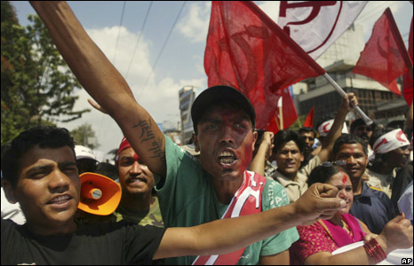 Nepalese celebrate the end of monarchy outside the convention hall