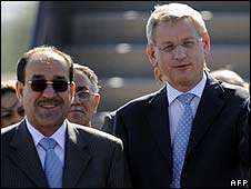 Iraqi Prime Minister Nouri Maliki (left) is greeted by Swedish Foreign Minister Carl Bildt as he arrives for the  Stockholm conference on 28 May