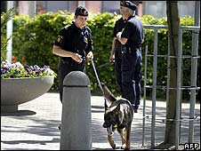 Police with a sniffer dog check the area around the Swedish conference centre  on 28 May