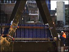 Worker inspects Liverpool Street bridge