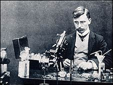 Francis Martin Duncan with microscope