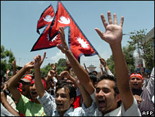 Nepali people gather to celebrate outside the royal palace in Kathmandu on 29 May, 2008