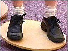 Pupil on a wobble board