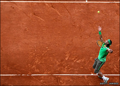 Nadal returns after the rain break in menacing form, dropping just one more game as he beats Devilder 6-4 6-0 6-1