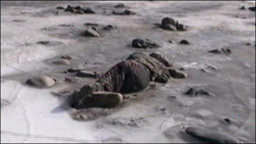 Frozen body in river