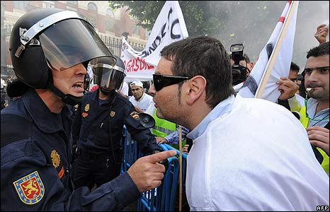 Protester and policeman at fuel price protest in Madrid