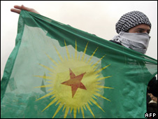 A Kurdish youth holds a PKK flag (file photo)